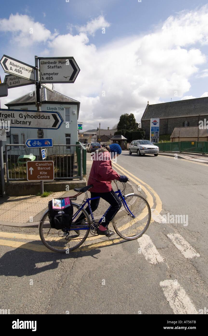 old woman cyclist Tregaron village Ceredigion mid wales UK - Stock Image