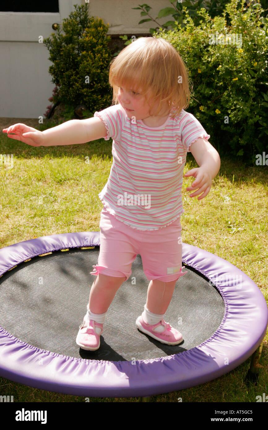 Wiltshire England UK Children Child Girl 0 2 Garden trampoline - Stock Image