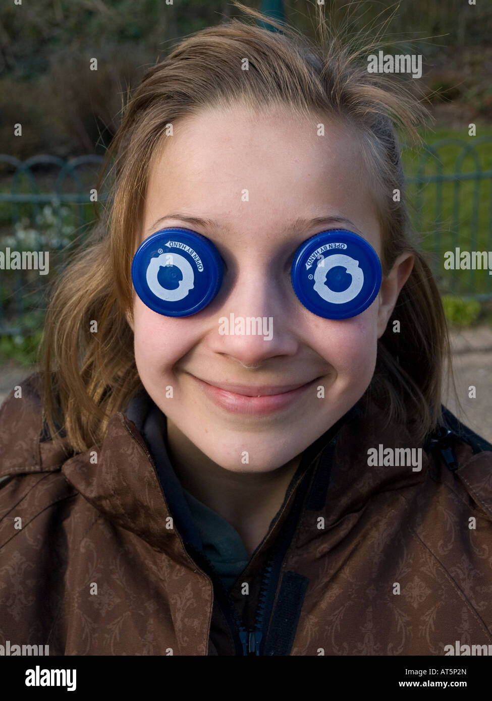 child with bottle top eyes 2008 Stock Photo
