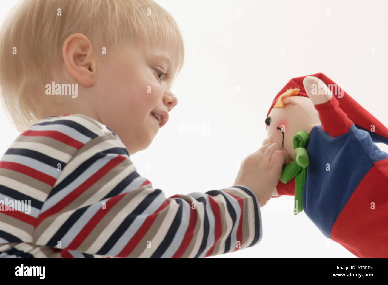 Kind spielt mit Kasperl - Stock Image