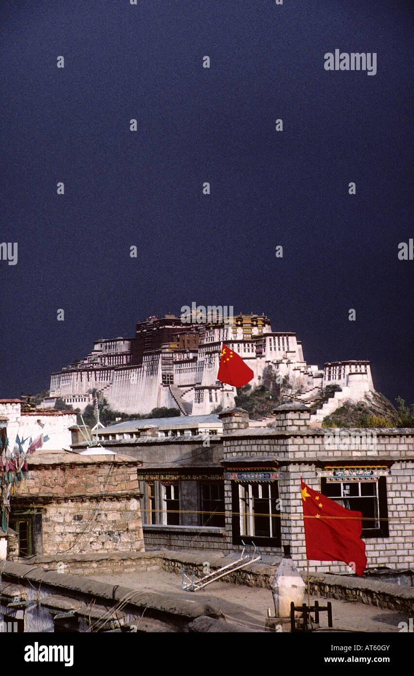 View of the Potala Palace over the Lhasa skyline complete with Chinese flags, Tibet - Stock Image