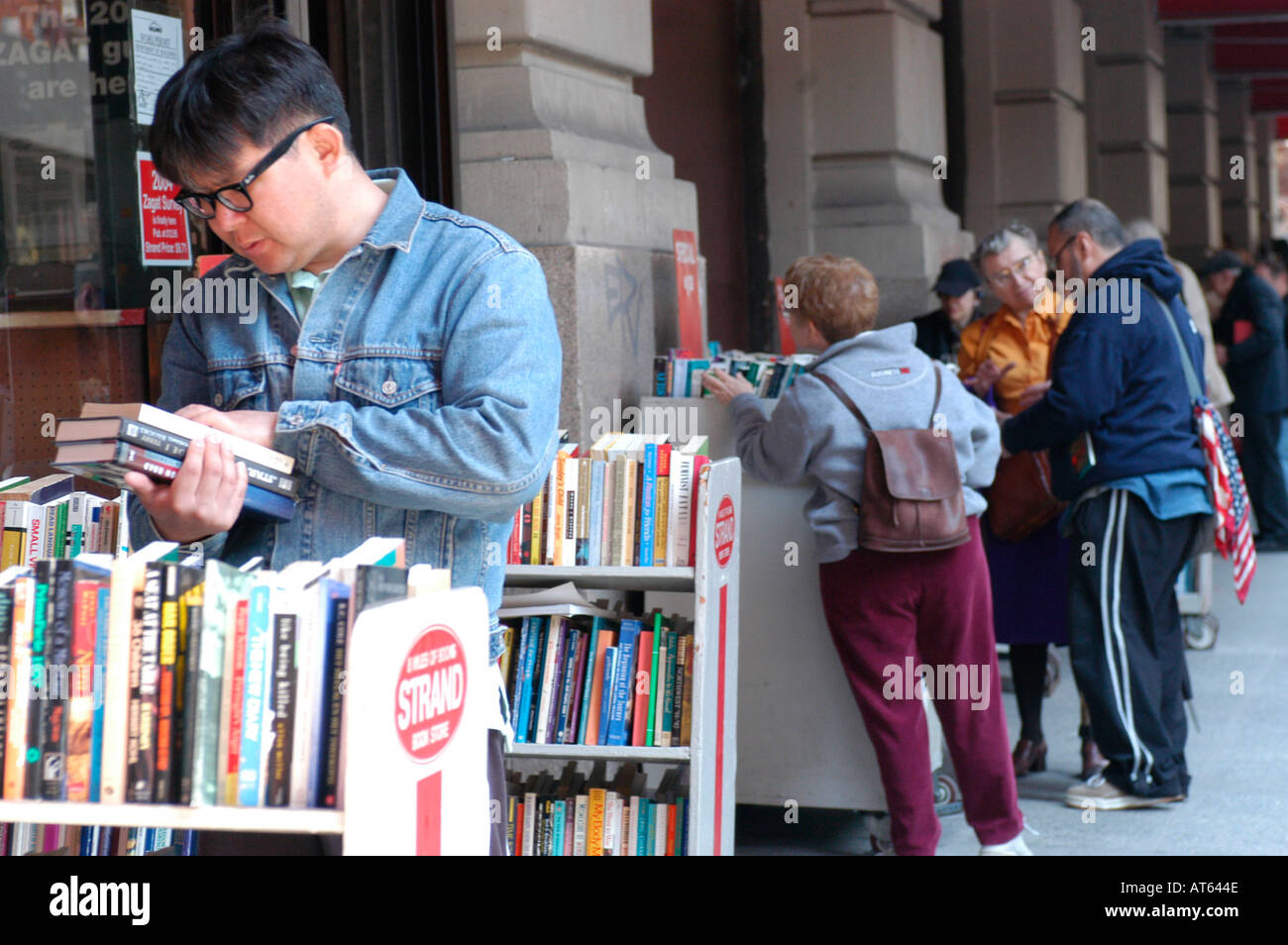 People browsing for books outside The Strand Bookstore  - Stock Image