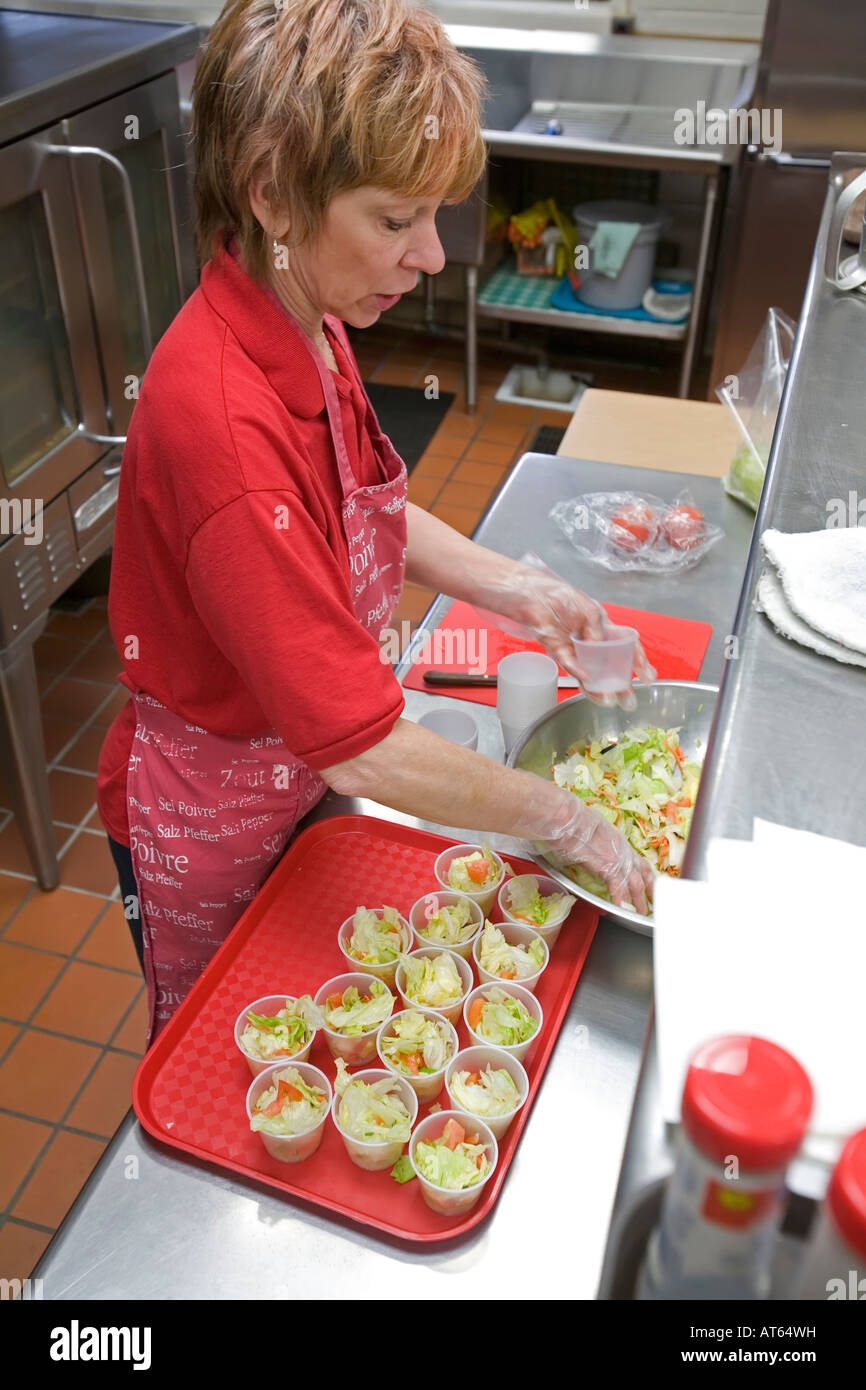 Dearborn Michigan Debra Sabaugh making salads in the cafeteria at Lindbergh Elementary School - Stock Image