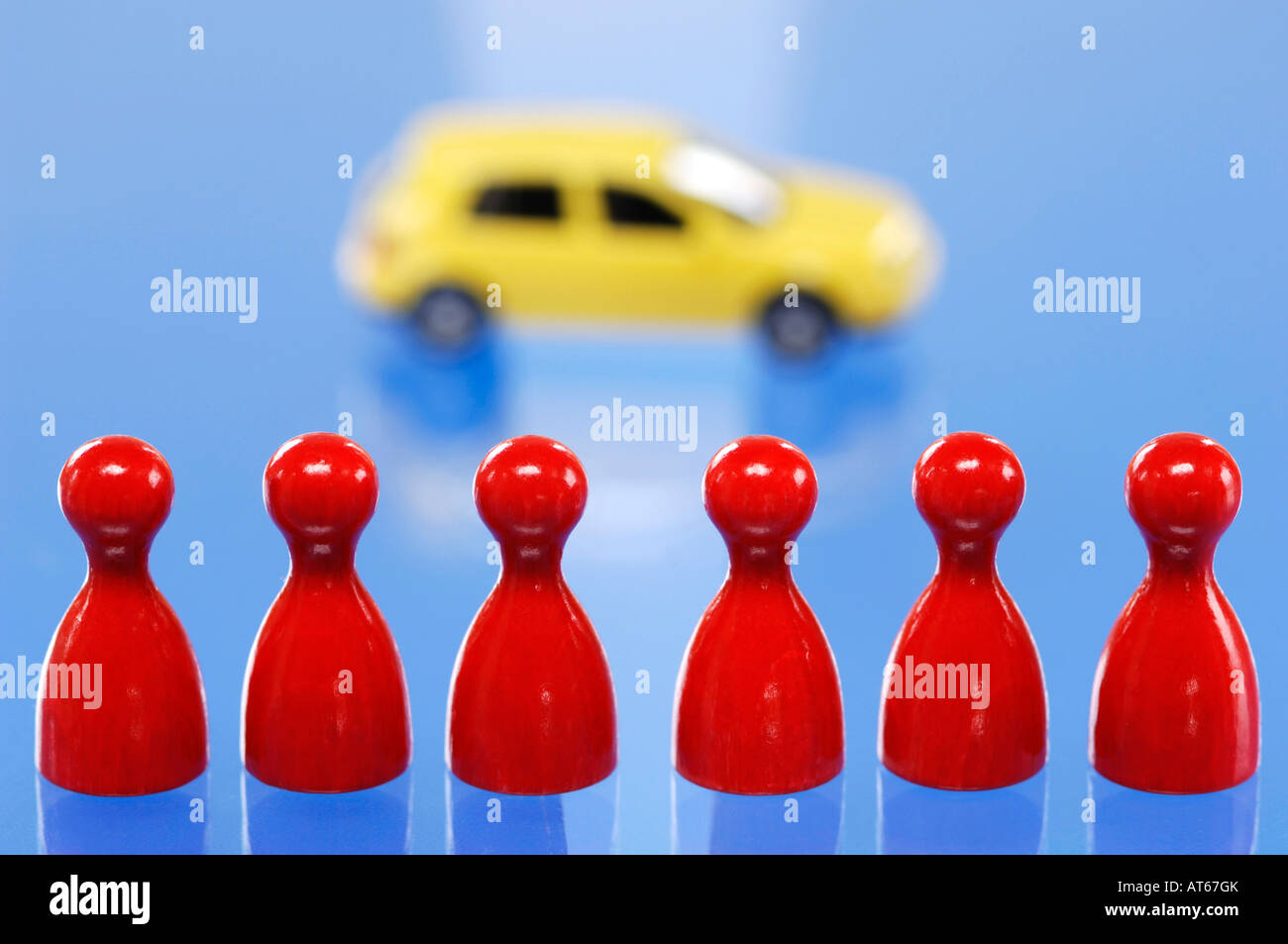 Game pieces in a row, toy car in background - Stock Image