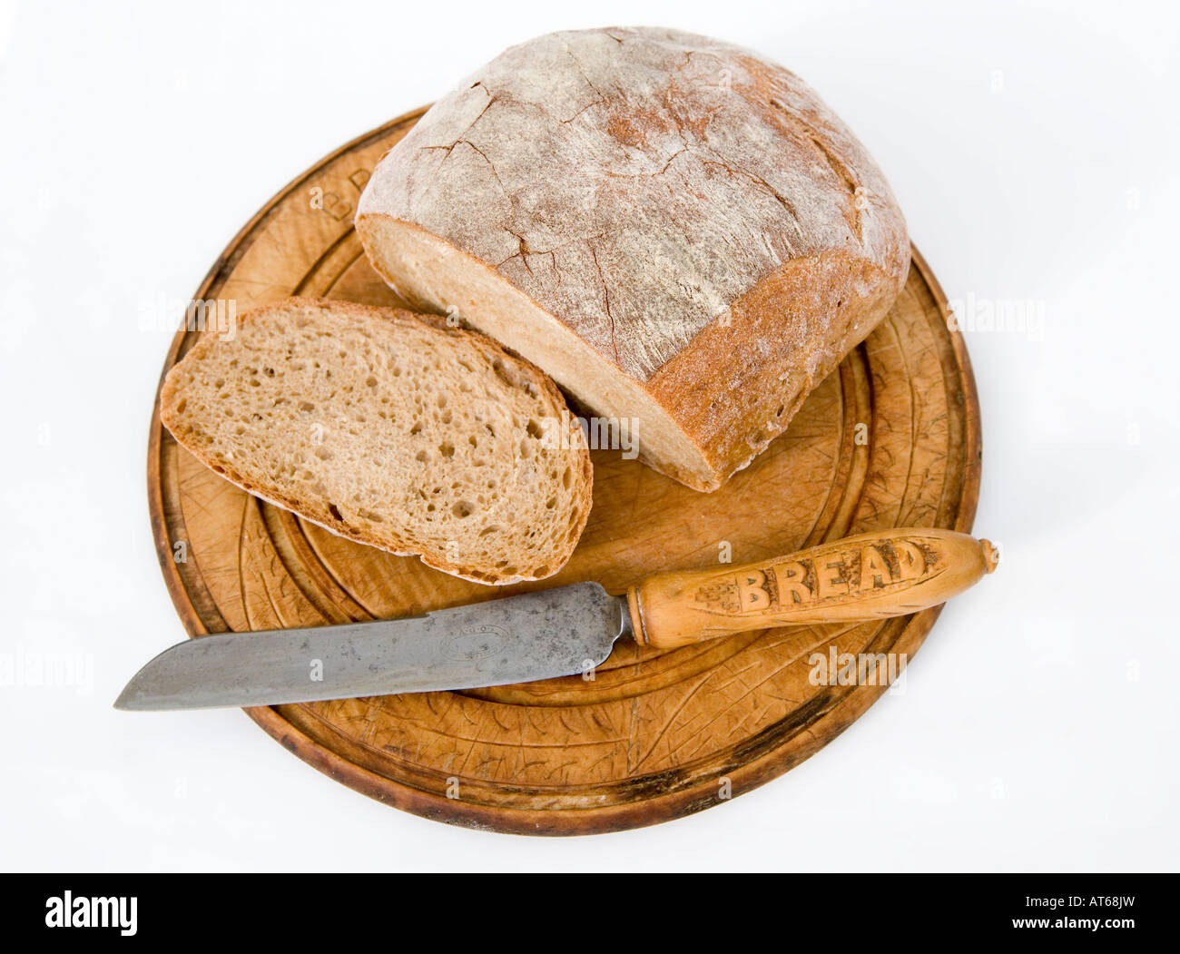 organic wholemeal loaf of bread on a vintage bread board with bread