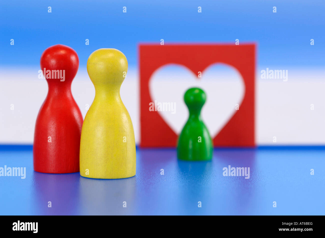 Game pieces, heart in background - Stock Image