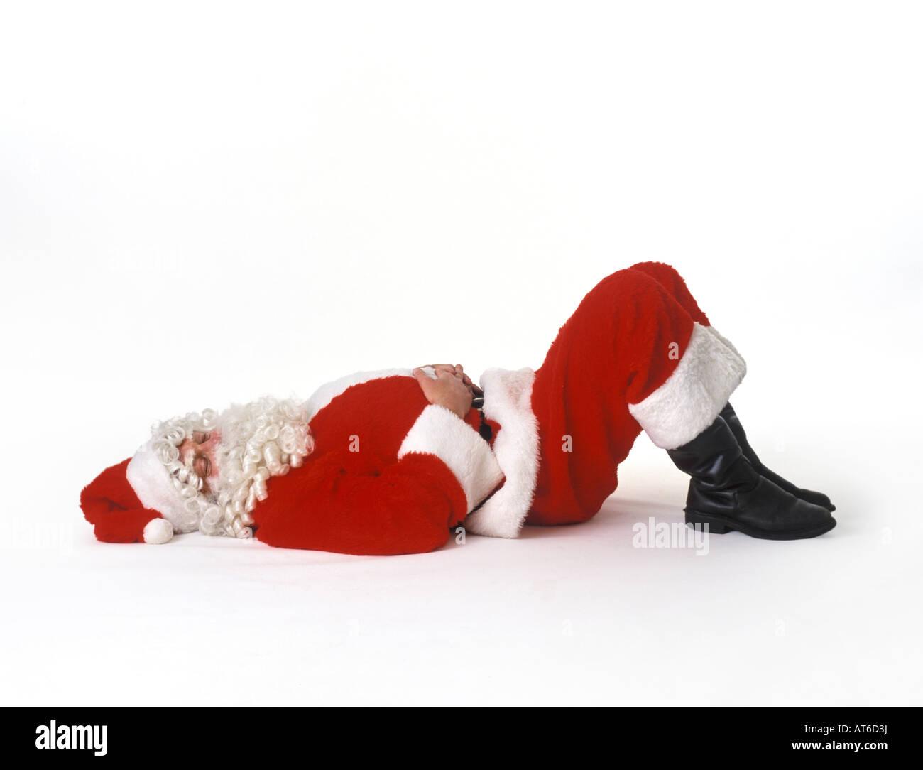 Sleeping Santa Claus on white background - Stock Image