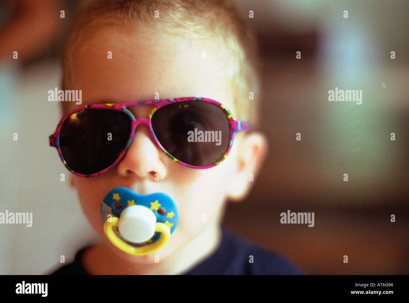 b0ca746dbe79 2 or 3 year old blond boy sucking dummy and wearing sunglasses Stock ...