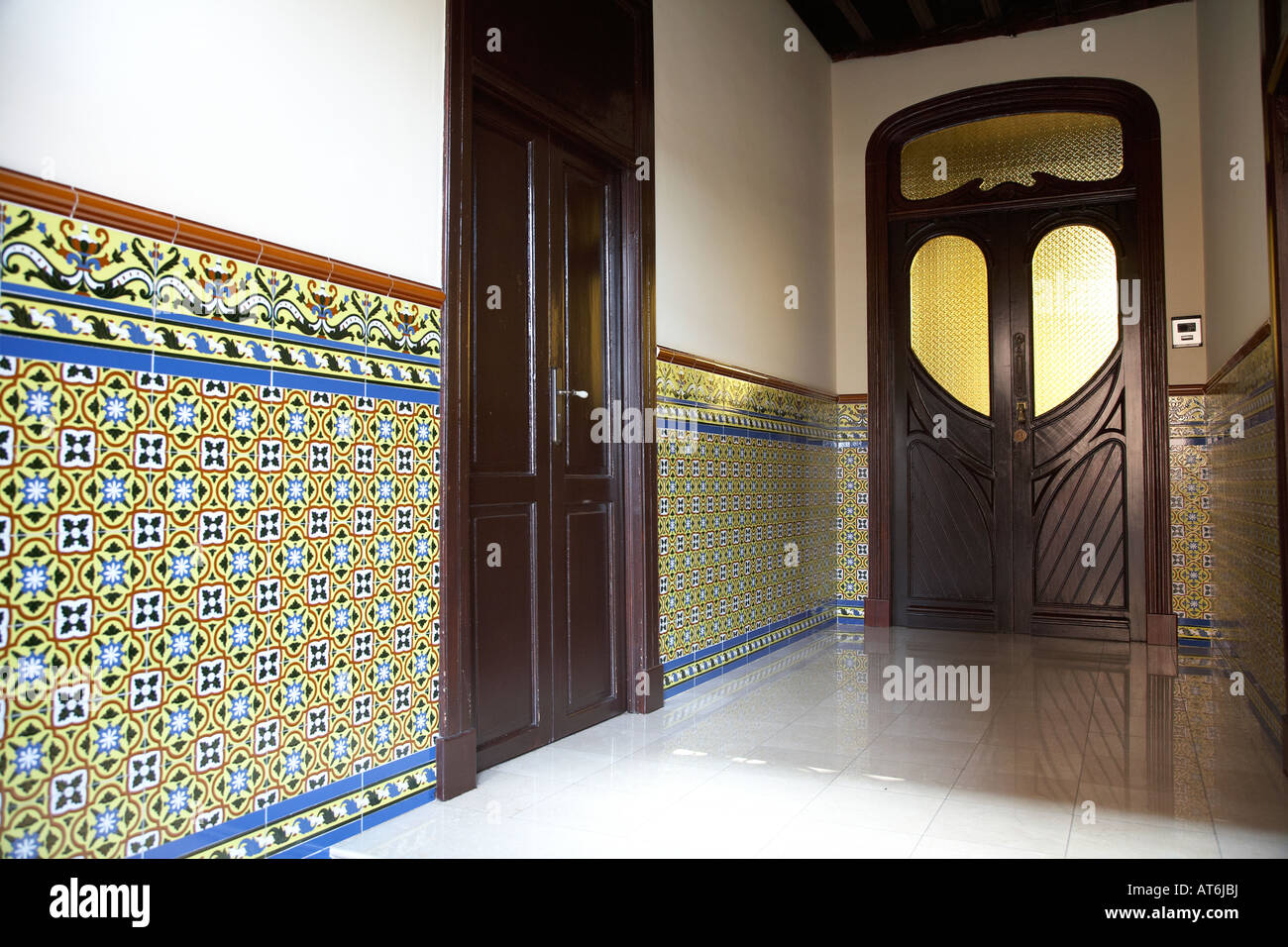 wooden doorway and tiled entrance hall to house door in la laguna tenerife canary islands spain - Stock Image