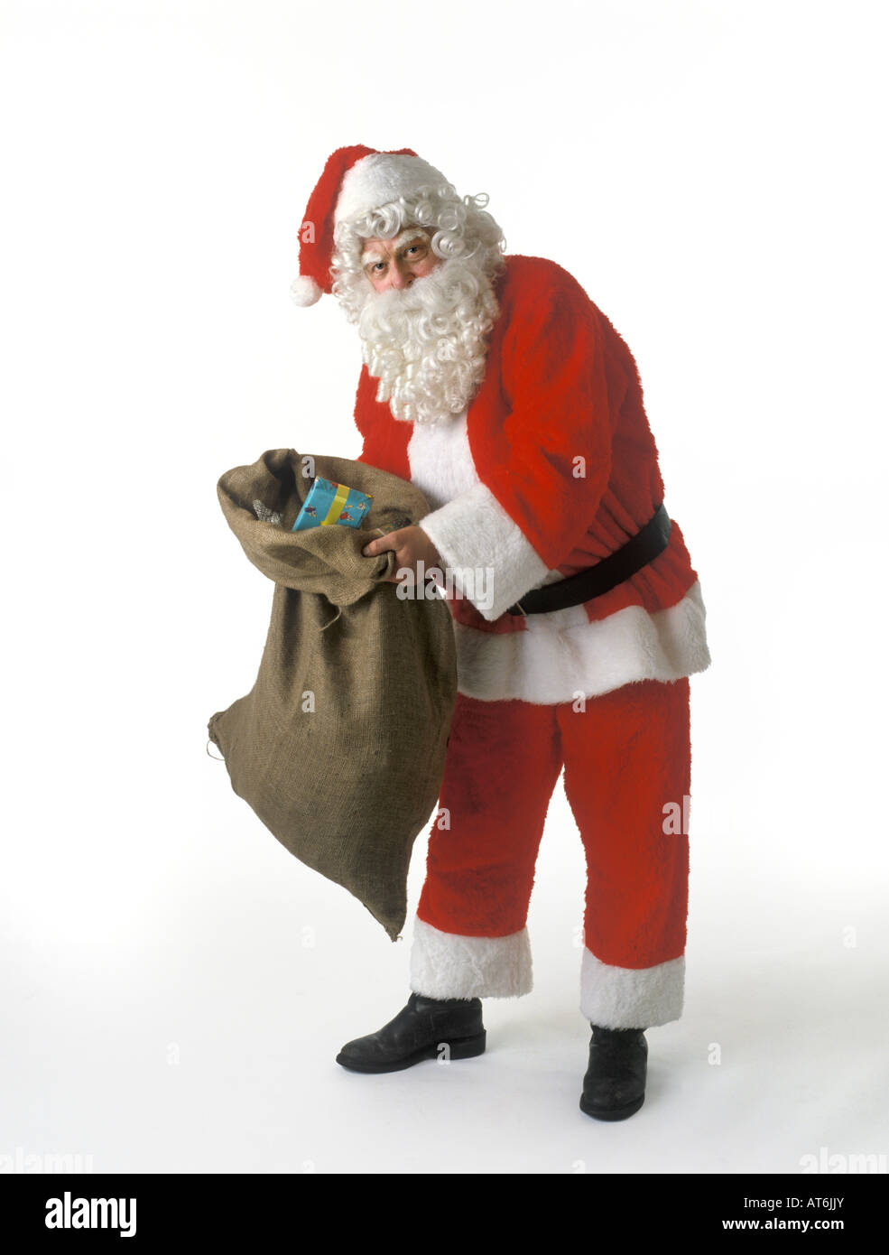 Santa Claus with a sack full of presents - Stock Image