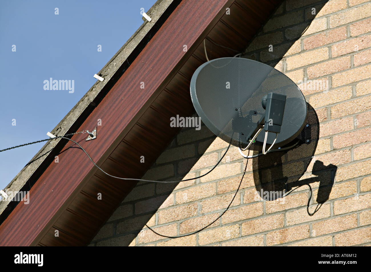 Cable Tv Dish Stock Photos Images Alamy Satellite House Wiring Receiver And Tied To Facia Of Roof On Domestic Wales Uk