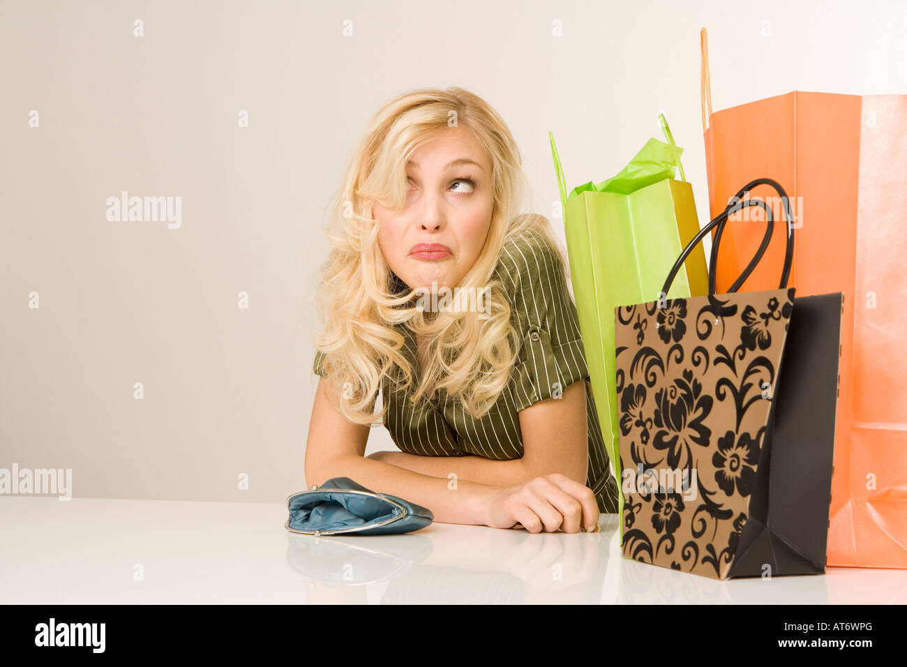 Blonde woman with shopping bags, portrait - Stock Image