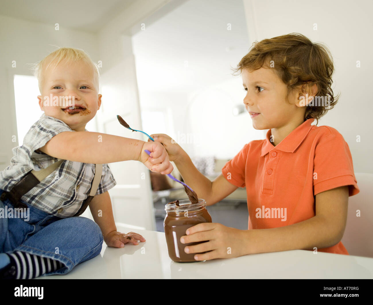 Two boys (4-5), (12-24 months), portrait - Stock Image
