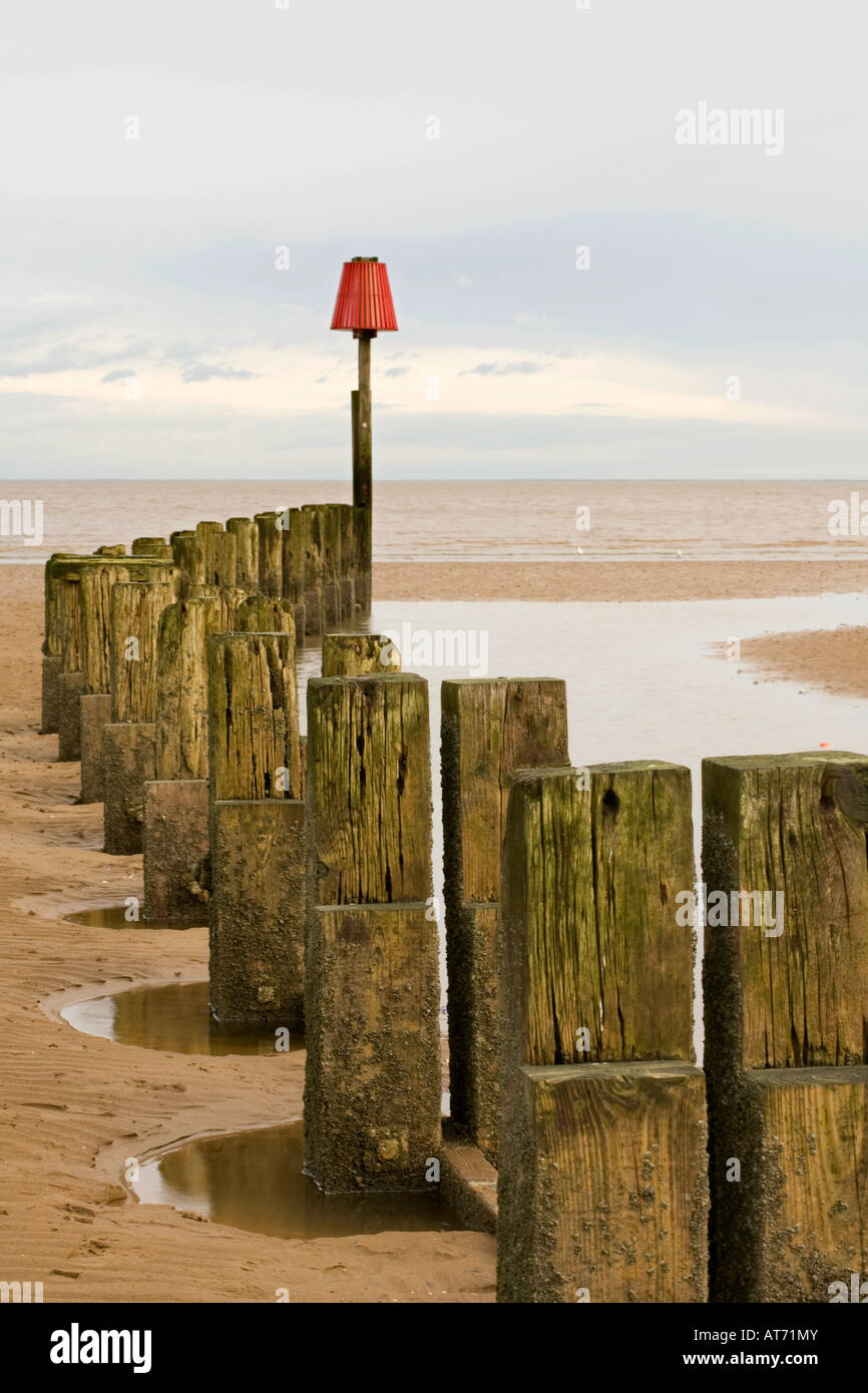Breakwater and Groynes on Cleethorpes Beach North East Lincolnshire - Stock Image