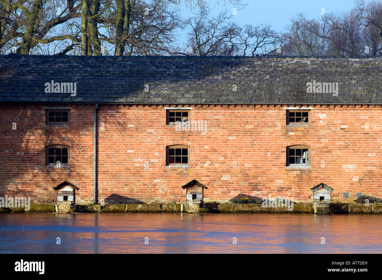 Ducks wooden  nesting boxes at Shugborough Mill pond in Staffordshire 'Great Britain' - Stock Image