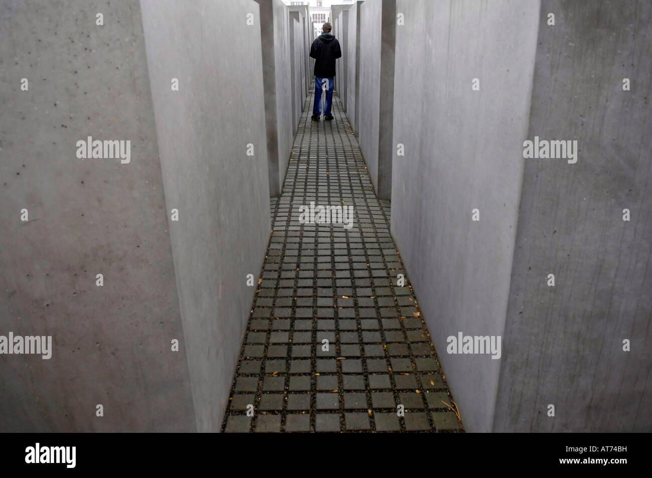 berlin holocaust memorial human figures grey concrete stone jews