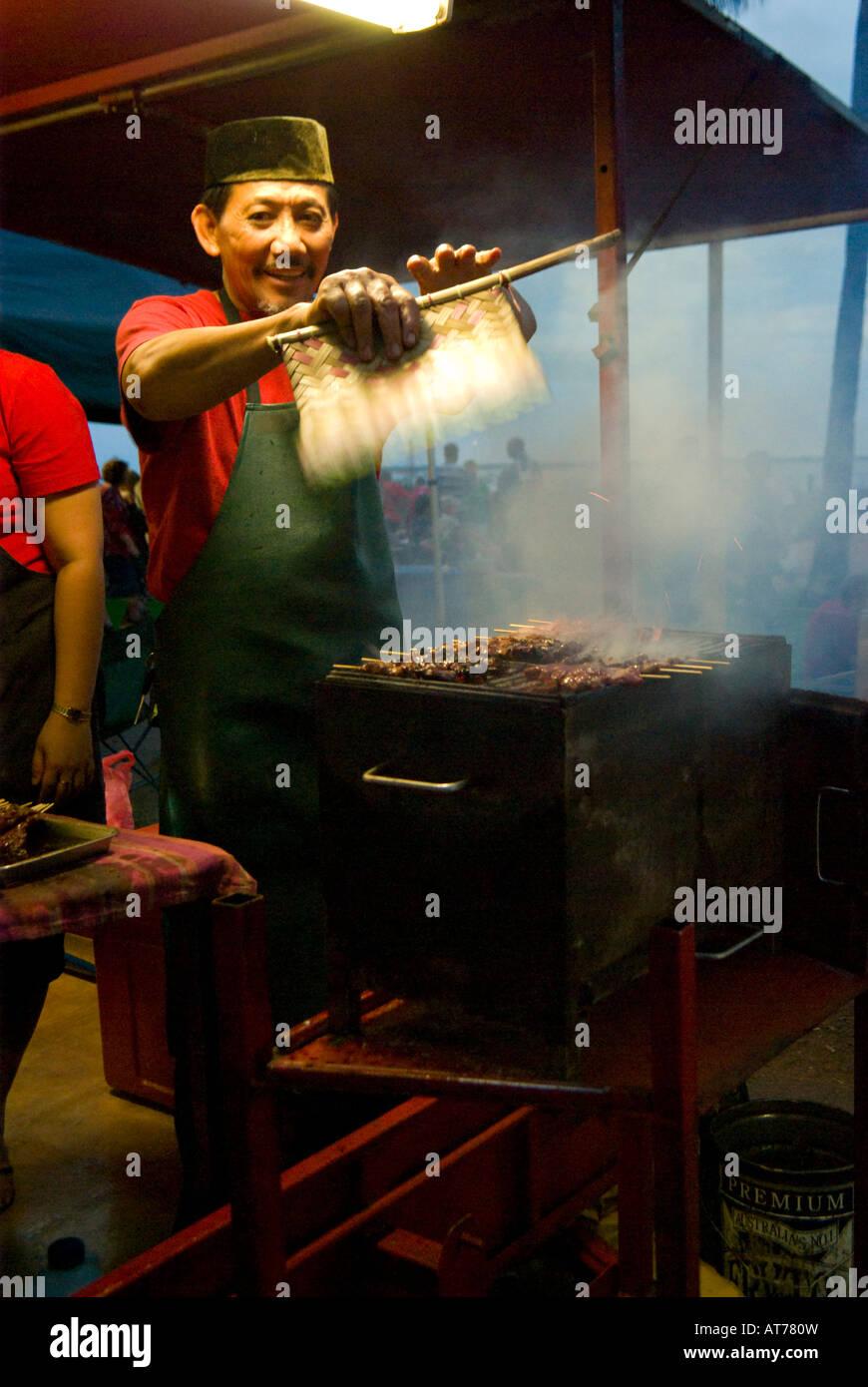 Asian Kebab Chef at Markets at Mindil Beach in Darwin - Stock Image