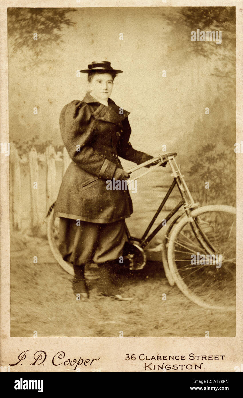 Victorian 1890s Cabinet Card Photograph of a woman with Bicycle - Stock Image