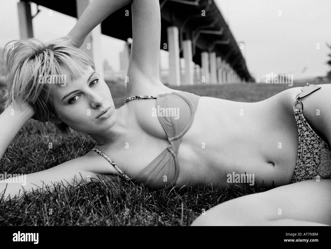 Young woman wearing bikini in Riverside Park New York City - Stock Image