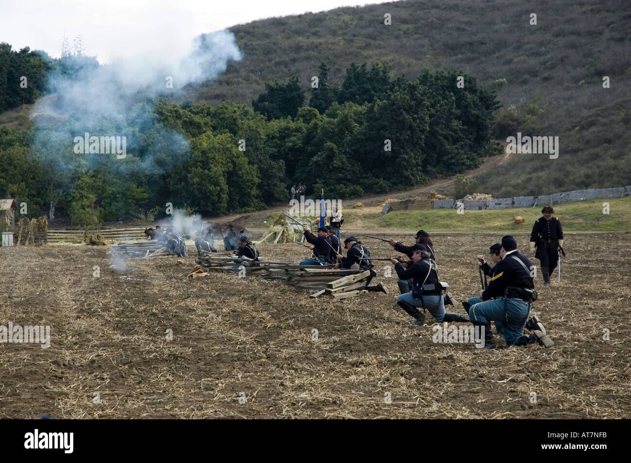 Firing squad shooting blanks at Civil War reenactment event - Stock Image