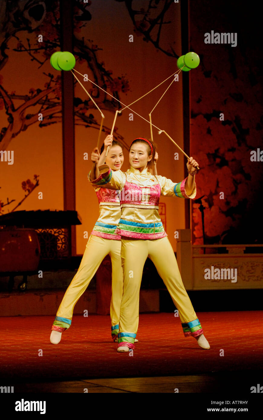 Acrobatic performers juggle spools on strings at Sichuan Opera Chengdu China - Stock Image