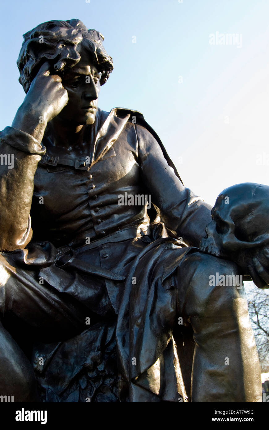 A statue of Hamlet holding the skull of Yorick, Stratford upon Avon, Warwickshire, England, UK. - Stock Image