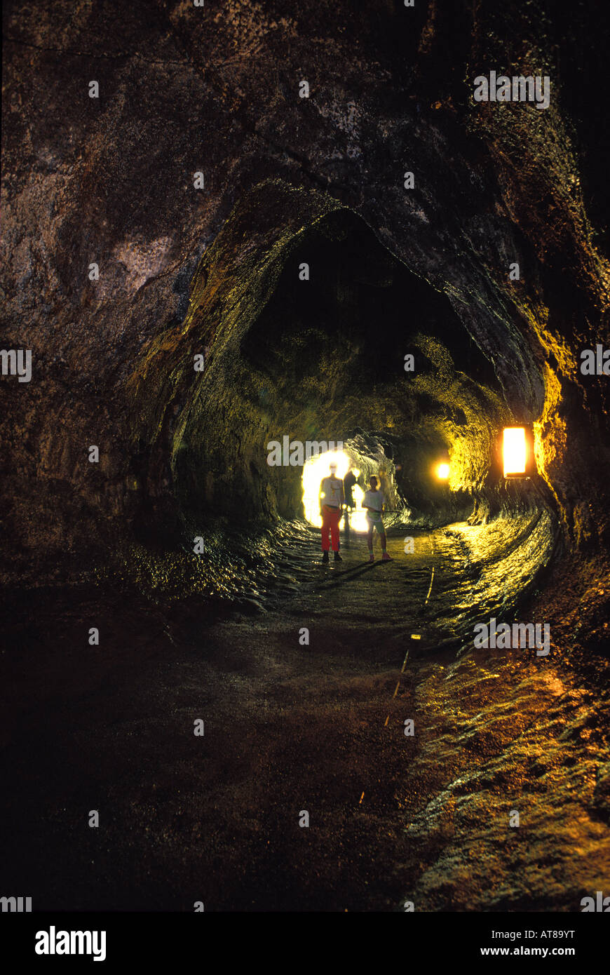 People exploring the interior of the Thurston lava tube at the Hawaii national volcano park Stock Photo