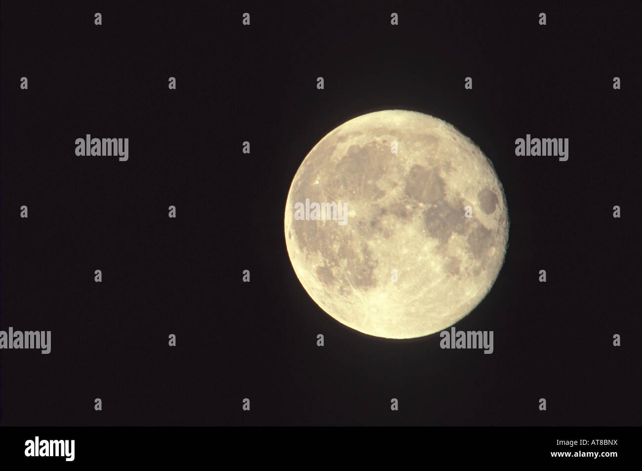 Luminous full moon against a black sky. - Stock Image