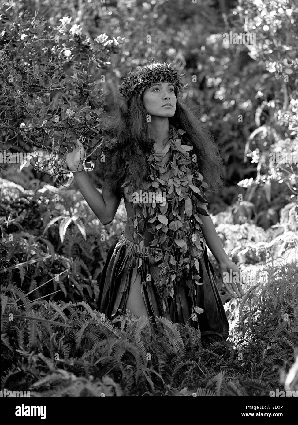 Young Hawaiian girl  near 'Steam Vents' in Hawaii Volcanoes National Park, wearing maile lei and lei poo - Stock Image