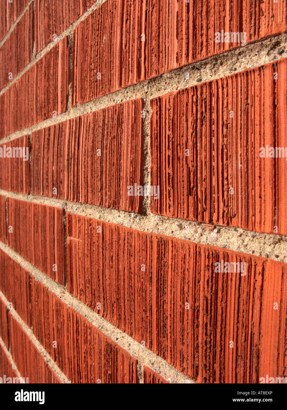 row of red pointed bricks on the gable wall of a house running off into the distance - Stock Image