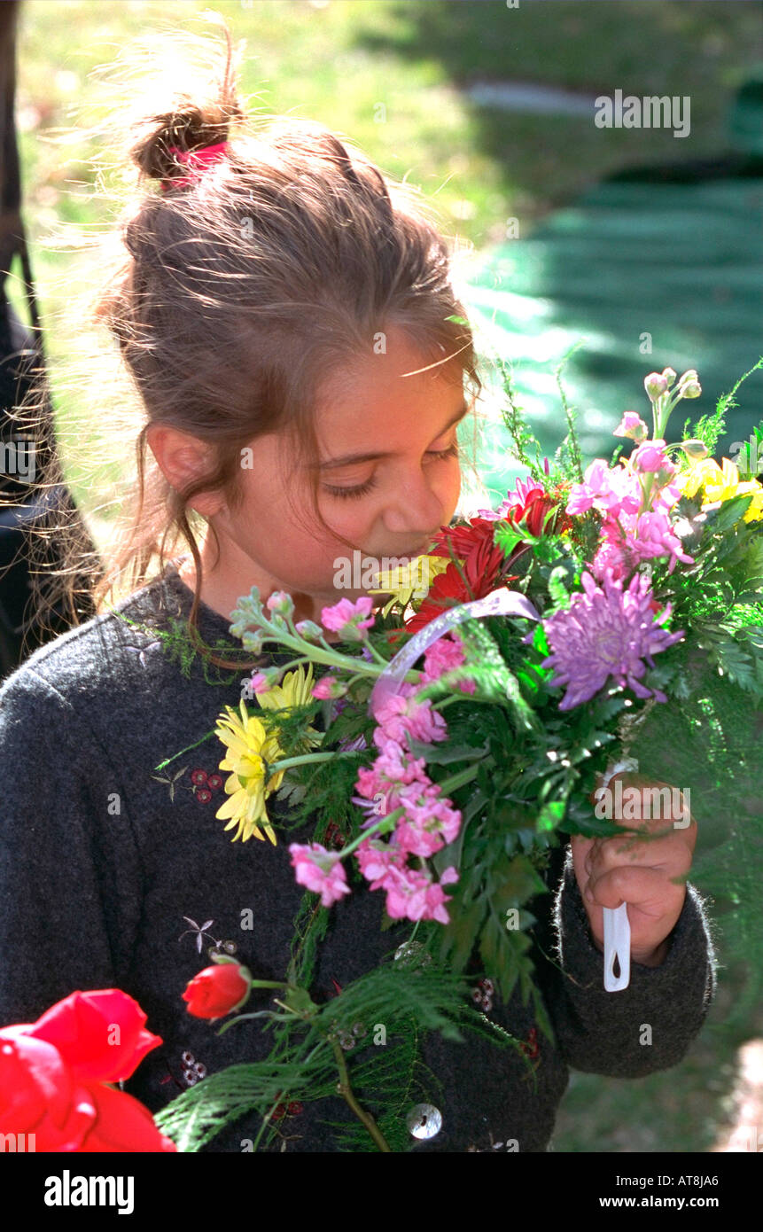 Girl Age 7 Smelling Bouquet Of Flowers At Grandmas Funeral Crystal