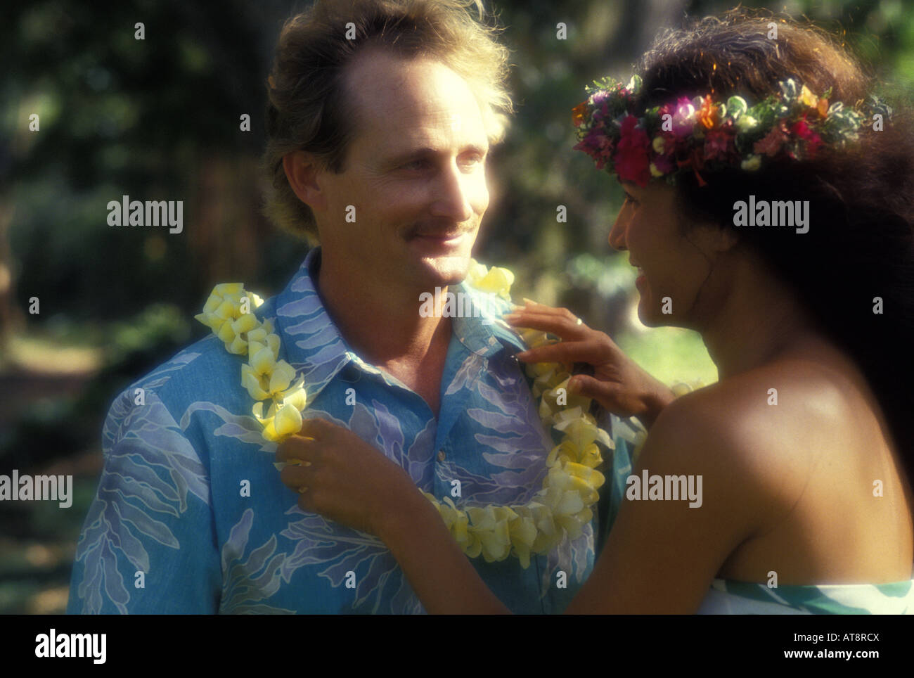 Tourist arriving to hawaii receiving a plumeria lei greeting from an tourist arriving to hawaii receiving a plumeria lei greeting from an island woman m4hsunfo