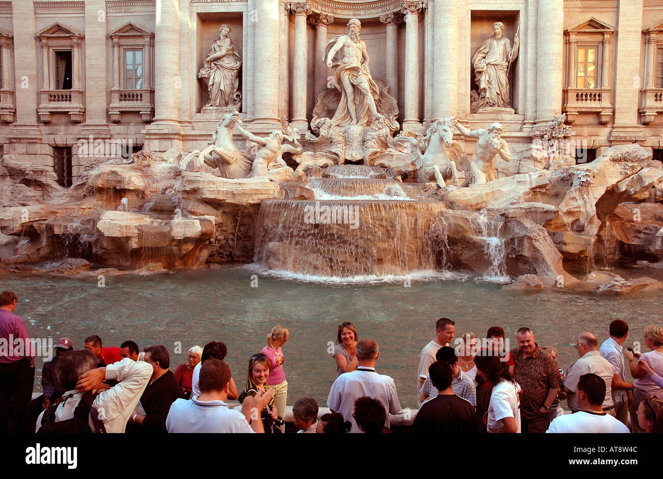 The Trevi fountain associated with Fellini's 'La Dolce Vita' attracts hordes of tourists. It was created by Nicolo Salvi in 1762 - Stock Image