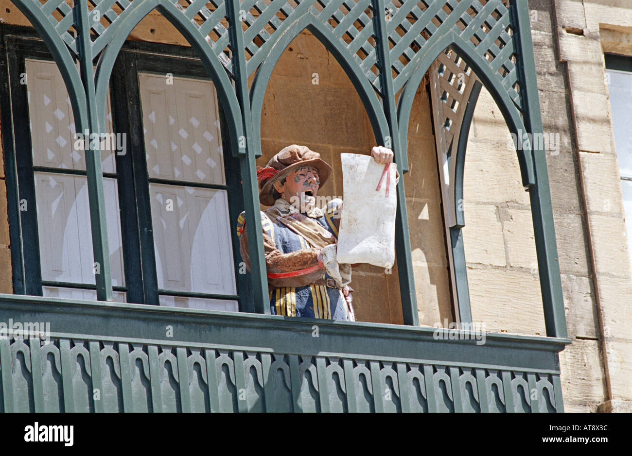 Carved and likelike figurine of a town crier making an announcement from a wooden balcony Valletta Malta - Stock Image