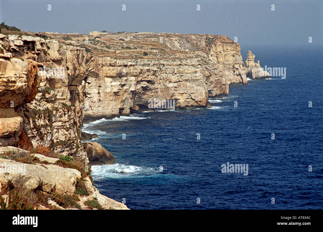 Maltese cliffs Gozo Mediterranean sea Malta Near a supposedly haunted cave - Stock Image