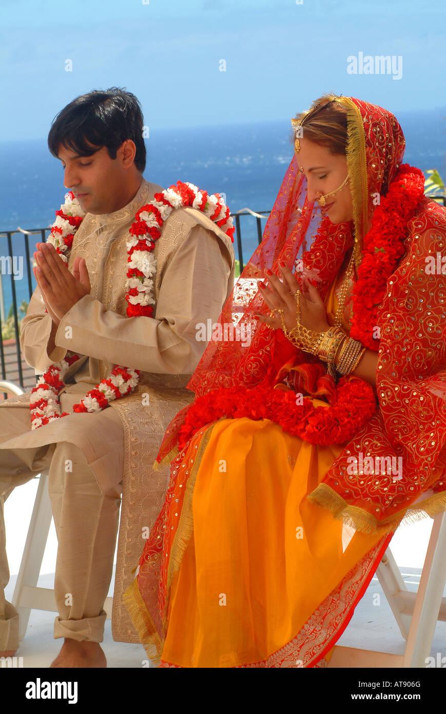 Tradditional Hindi wedding with groom wearing carnation