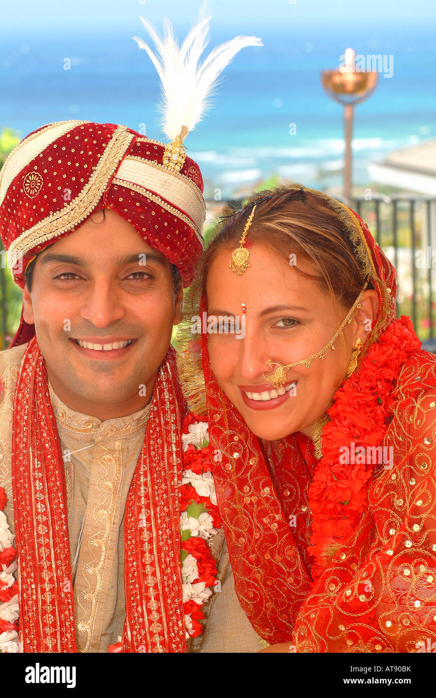Tradditional Hindi wedding with groom wearing carnation flowers and
