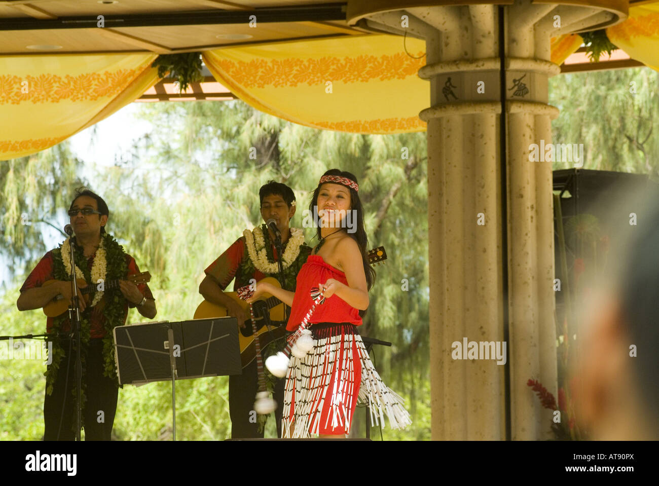 Hula dancers perform at Kapiolani park bandstand on May day, also known in Hawaii as lei day Stock Photo