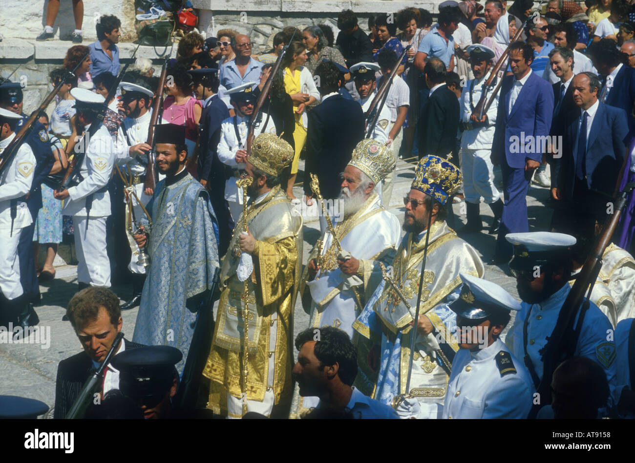 popes in colorful vestments staircase of th church in Tinos feast of Panagia pilgrimage cyclades Greece Stock Photo