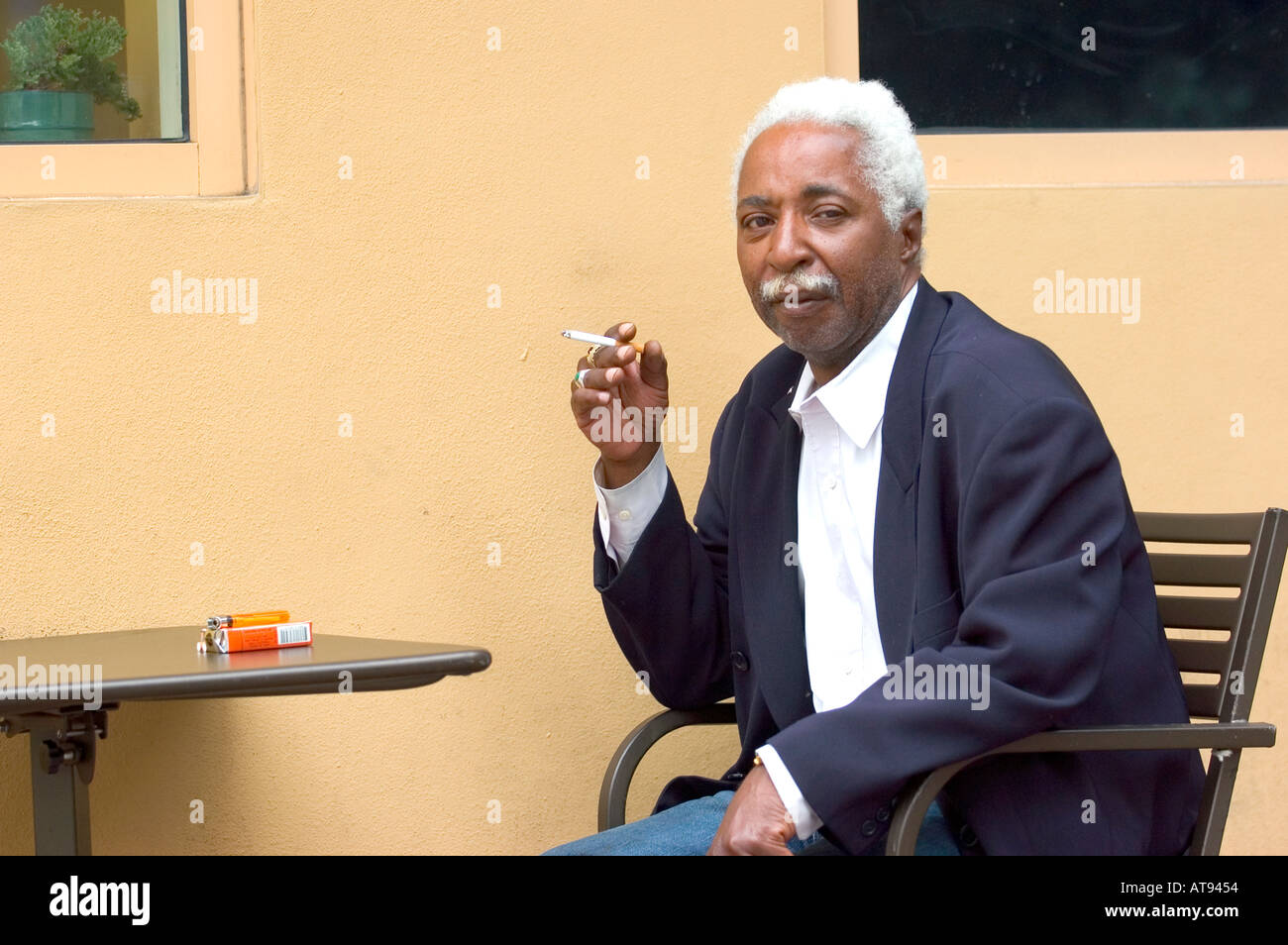Miami Florida Street Life Black Senior Male Smoking Cigarette - Stock Image