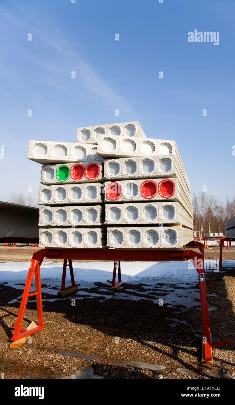 Storage of prefabricated hollow core concrete construction elements - Stock Image