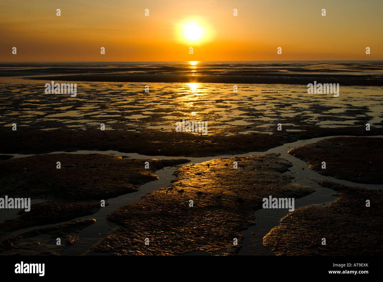 Sunset over the mudflats in Kakadu - Stock Image