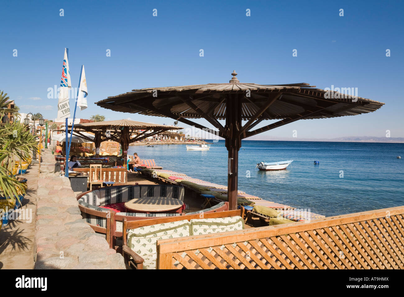 Dahab Sinai Peninsula Gulf of Aqaba Egypt Asia outdoor cafe and bay in seaside resort on Red Sea east coast - Stock Image