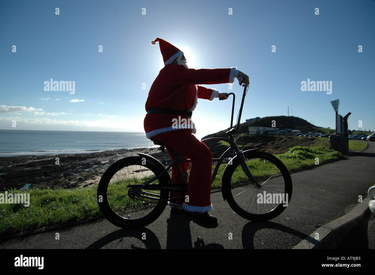 Santa On A Cruiser Bike At Limeslade Swansea Wales Uk Stock Photo Alamy