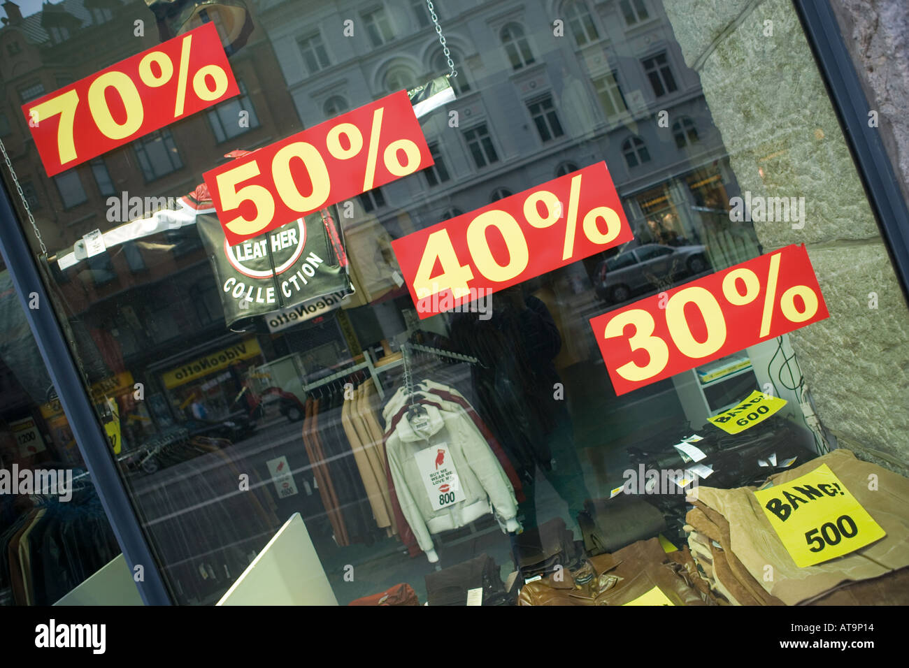 Clothing shop window Copenhagen Denmark advertising discounts - Stock Image