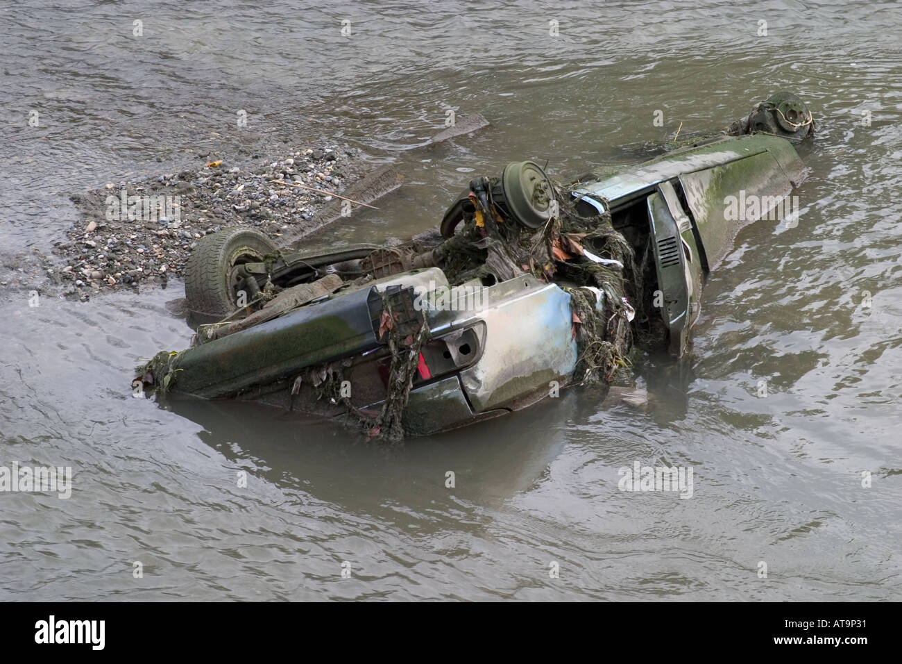 Abandoned car wreck dumped in the river Lea. London, England - Stock Image