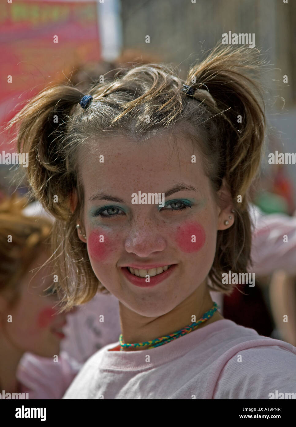 Attractive young perform with freckles and red makeup on cheeks poses, Edinburgh Fringe Festival, Scotland, UK, - Stock Image