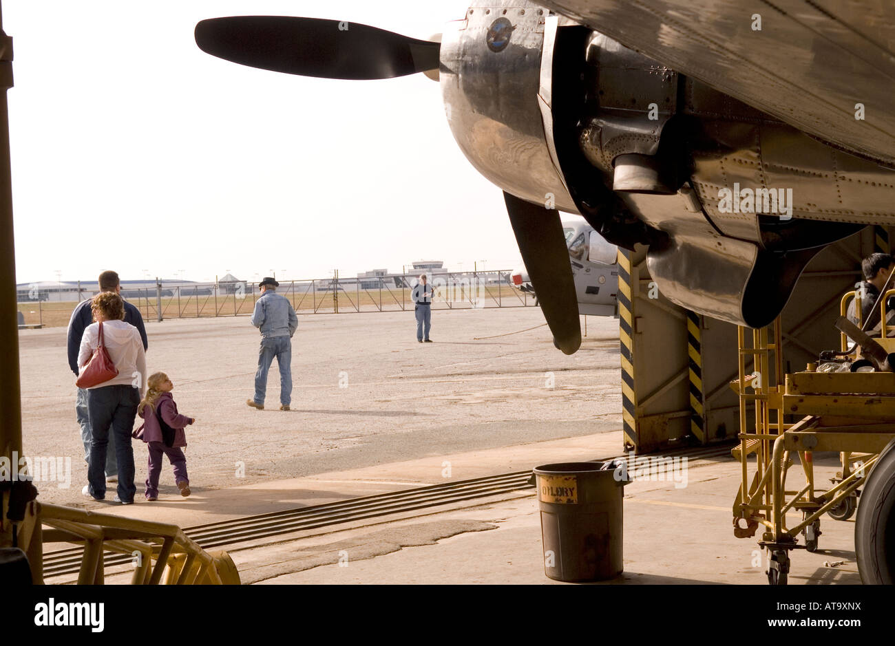 Little Girl Turns to Look Back at Plane in Hanger at Carolinas Aviation Museum in Charlotte NC USA - Stock Image