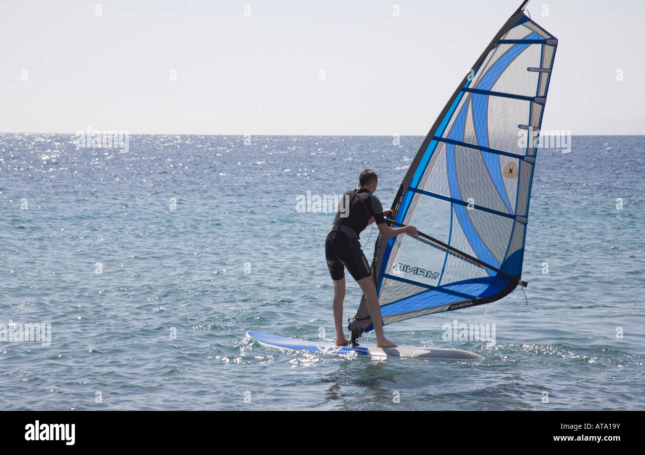 Taba Sinai Egypt North Africa February Young man learning to wind surf on the calm sea of the Gulf of Aqaba - Stock Image