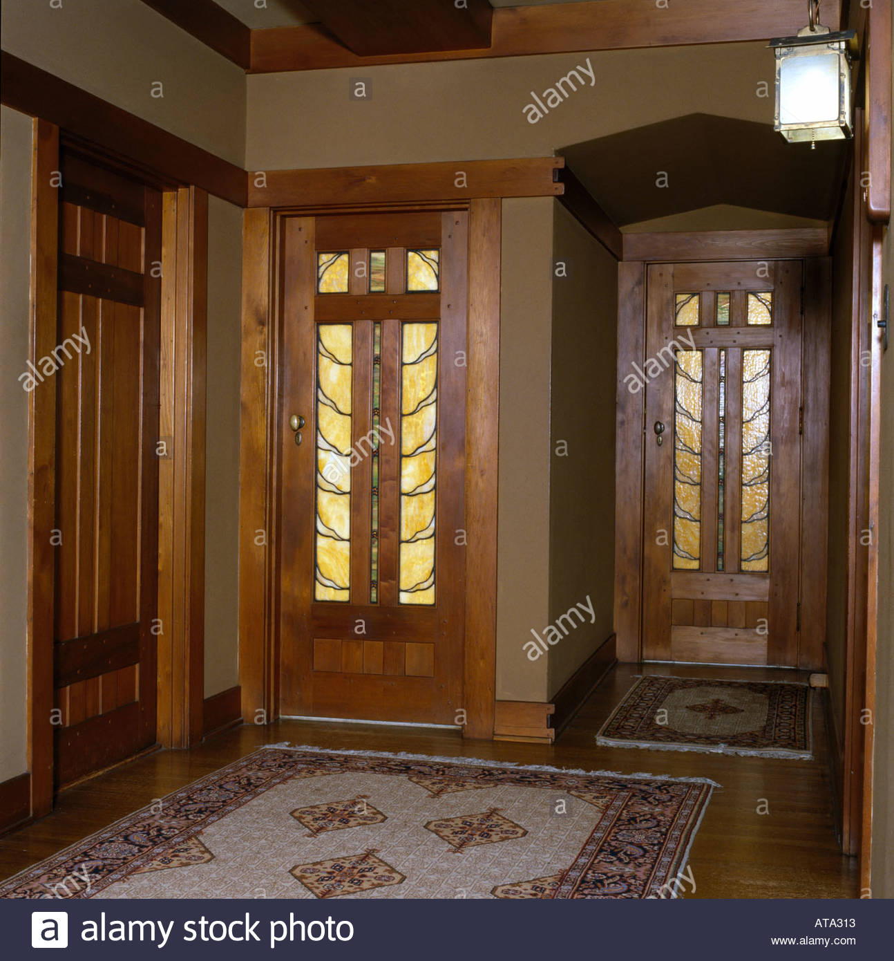 The David B. Gamble House Pasadena California. Opalescent-glass doors in upstairs landing. Architect Greene and Greene & The David B. Gamble House Pasadena California. Opalescent-glass ...